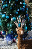 Christmas reindeer, decoration style with Christmas tree and Christmas gifts Royalty Free Stock Images