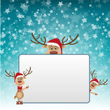 Christmas reindeer displaying blank sign. Three cute illustrated Christmas reindeer wearing boots, bows, and Santa hats bring attention to a very large framed Stock Image