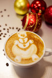 Christmas reindeer drawing on latte art coffee cup. Shot closeup Stock Image