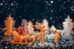 Christmas reindeer driven gifts. Royalty Free Stock Photos