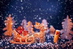 Christmas reindeer driven gifts. Stock Photos