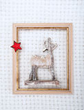 Christmas reindeer framed picture with  fur and red star Stock Images