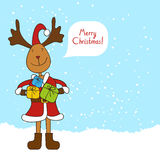 Christmas reindeer with gifts Stock Images