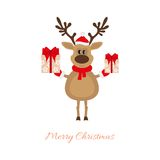 Christmas reindeer with gifts Stock Photo
