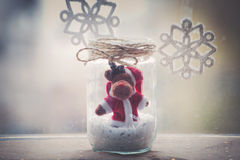 Christmas reindeer in glass jar decoration Royalty Free Stock Image