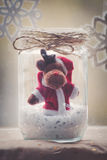 Christmas reindeer in glass jar decoration Royalty Free Stock Photo