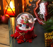 Christmas Reindeer in a Globe Royalty Free Stock Photography