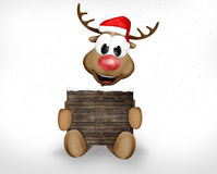 Christmas Reindeer holding sign Royalty Free Stock Photography