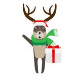 Christmas reindeer holds a gift box Stock Photos