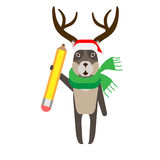 Christmas reindeer holds a pencil Royalty Free Stock Photo