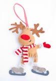 Christmas Reindeer on ice skates. stock images