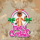 Christmas reindeer pointing at something in a circle. Merry christmas calligraphy. Old paper and Grunge effect with Stock Image