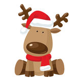Christmas reindeer in Santa`s red hat Royalty Free Stock Photo