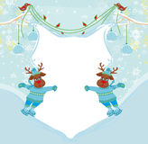 Christmas reindeer with scarf skates on ice Royalty Free Stock Photography
