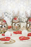 Christmas reindeer and snow. Christmas table decoration with candle hearts  funny reindeer  bauble pearls moody decor vintage elegant Stock Images