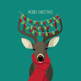 Christmas Reindeer wearing red scarf and festive lights Stock Photo