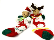 Christmas Reindeers. Christmas reindeer with sock to guard noel gifts Stock Images
