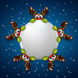 Christmas reindeers holding snowball over blue background Stock Image