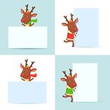 Christmas Reindeers with posters Stock Images