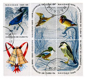 Christmas release of postage stamps. Postage stamp let out for Christmas 1965 on Cuba. A series devoted to birds of local fauna Royalty Free Stock Image