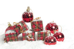 Christmas resents and decorations in the snow Stock Photography