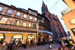 Christmas Restaurant and Holiday hotel  with Notre-Dame view. STRASBOURG, FRANCE - DEC 06, 2015: Place de la Cathedralee with impressiove view over hte Notre Royalty Free Stock Images