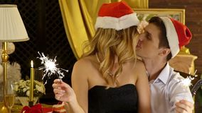 Christmas restaurant with loving couple in Santa hat celebrate Xmas stock footage