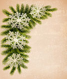 Christmas retro background with christmas tree bra. Nches and snowflakes. Vector Stock Photography