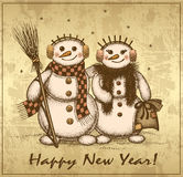 Christmas retro card with two snowmen boy and girl Stock Photo