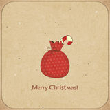 Christmas retro postcard with gift bag Royalty Free Stock Image
