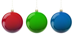 Christmas RGB balls. Multi-colored Christmas balls hanging on white. RGB colors. 3d render with HDR Royalty Free Stock Images
