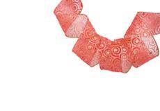 Christmas ribbon. Hanging Christmas ribbon isolated on white Royalty Free Stock Image