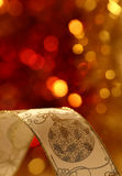 Christmas ribbon. Against blurred background stock image