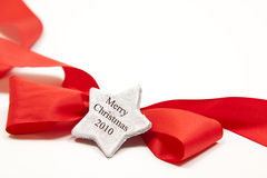 Christmas ribbon. Isolated red ribbon for any occasion with a silver star Stock Photo