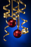 Christmas ribbon. With red balls and blue background Royalty Free Stock Photo