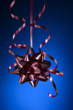 Christmas ribbon. And bow with blue background Royalty Free Stock Photography