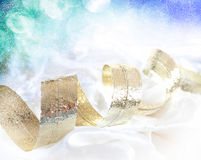 Christmas ribbon. And snow flurries background Royalty Free Stock Photography