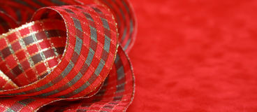 Christmas ribbon. Abstract of christmas ribbon on a red velvet background Stock Image