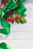 Christmas Ribbon, Berries and Cones Royalty Free Stock Photography