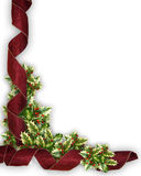 Christmas ribbon and holly border. Christmas Corner design with holly leaves and curled, red damask ribbon  for border, background or frame with copy space Royalty Free Stock Photos