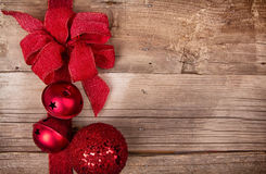 Christmas ribbon and ornaments on wooden background Royalty Free Stock Photos
