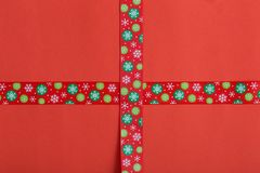 Christmas ribbon on paper background royalty free stock image