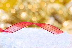 Christmas Ribbon in the Snow Royalty Free Stock Photo