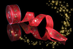 Christmas ribbon and stars Royalty Free Stock Photos