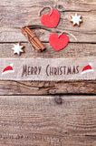 Christmas ribbon on wooden background Royalty Free Stock Photography