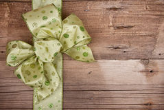 Christmas ribbon on wooden background. Green Christmas ribbon on rustic wooden background royalty free stock photography