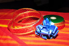 Christmas ribbons on red and yellow background Royalty Free Stock Photography