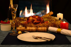 Christmas roast chicken. With champagne and strawberries by a gas fireplace Royalty Free Stock Photos