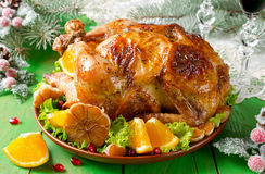 Christmas roast chicken with oranges Royalty Free Stock Photo