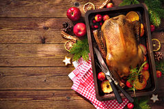 Christmas roast duck with apples and oranges on baking tray Royalty Free Stock Image
